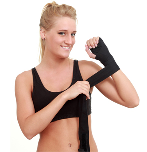 Female boxer uses athletic sports guard